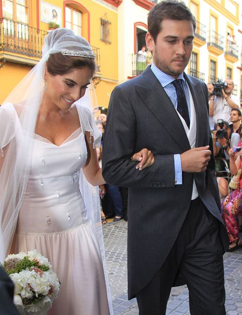 Clothing, Hair, Coat, Trousers, Bridal veil, Shirt, Bridal clothing, Dress, Outerwear, Formal wear,