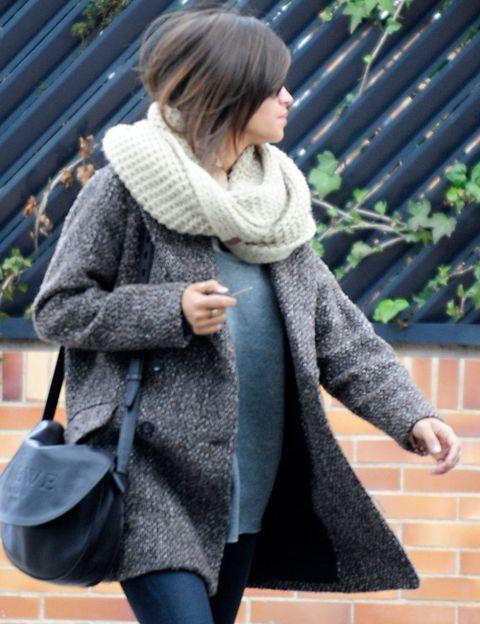 Clothing, Sleeve, Human body, Textile, Outerwear, Winter, Street fashion, Cardigan, Wool, Coat,