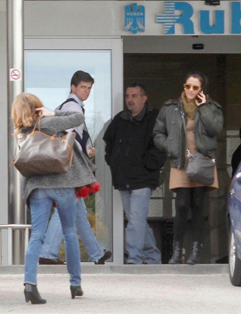 Clothing, Leg, Jacket, Trousers, Human body, Coat, Denim, Jeans, Textile, Standing,