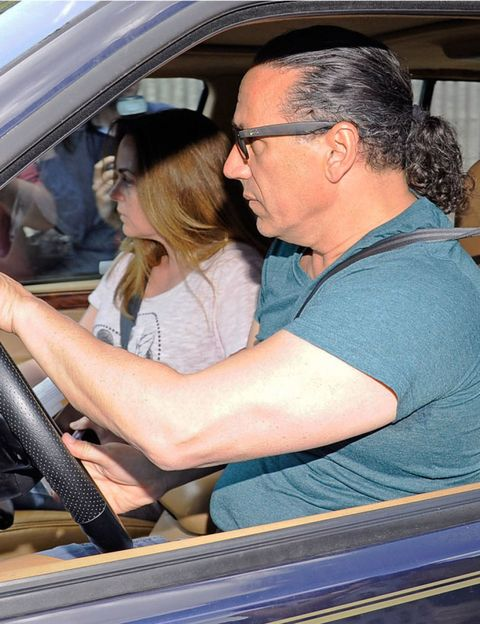 Glasses, Vehicle door, Interaction, Comfort, Car seat, Windshield, Automotive window part, Love, Steering wheel, Car seat cover,