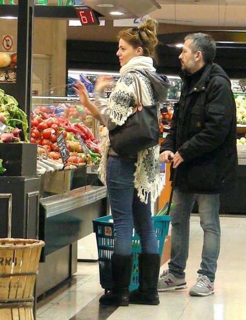 Trousers, Jeans, Jacket, Outerwear, Whole food, Public space, Denim, Retail, Marketplace, Produce,