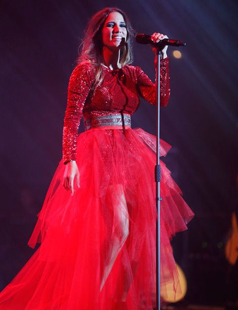 Microphone, Audio equipment, Event, Entertainment, Music, Performing arts, Red, Music artist, Music venue, Dress,