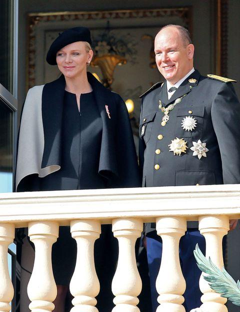 Face, Collar, Formal wear, Facial expression, Uniform, Hat, Baluster, Blazer, Military officer, Military uniform,