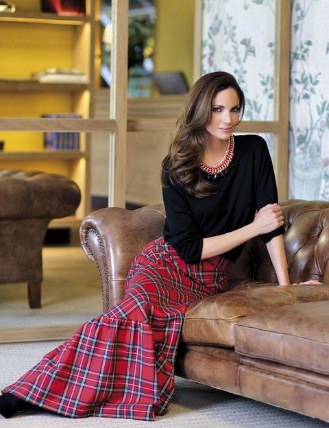Brown, Plaid, Tartan, Textile, Jewellery, Furniture, Shelf, Sitting, Interior design, Pattern,