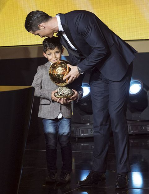 Trousers, Coat, Interaction, Trophy, Award, Award ceremony, Love, Suit trousers, Boot,