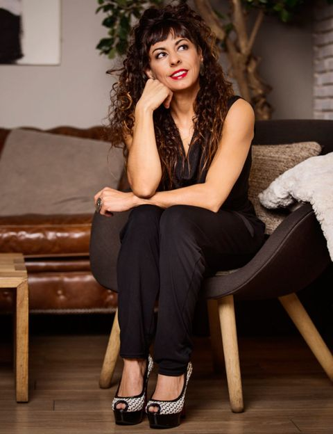 Clothing, Brown, Hairstyle, Shoulder, Joint, Sitting, Style, Couch, Beauty, Knee,