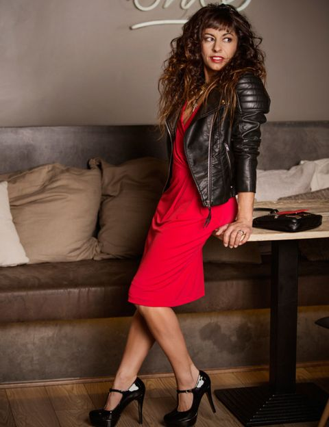 Clothing, Human leg, Shoe, Dress, Outerwear, Couch, Style, High heels, Knee, Jacket,