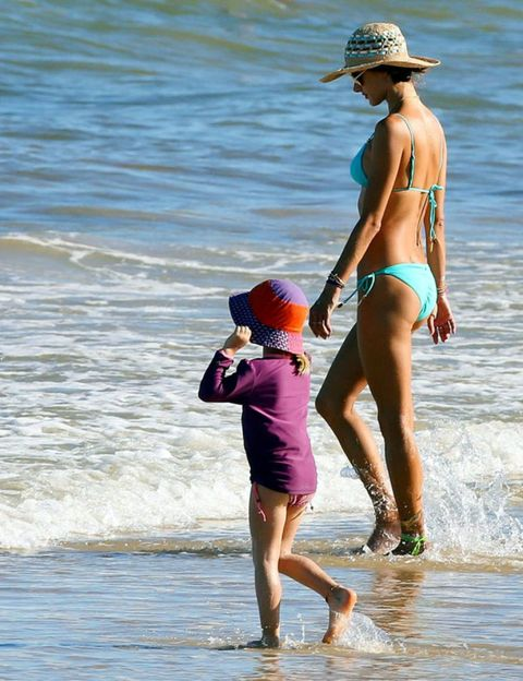 Clothing, Human, Fun, People on beach, Hat, Human body, Water, People in nature, Summer, Beach,