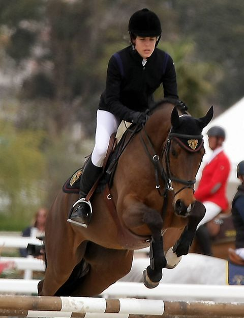 Show jumping, Vertebrate, English riding, Recreation, Equestrian sport, Shoe, Horse tack, Bridle, Jumping, Horse,