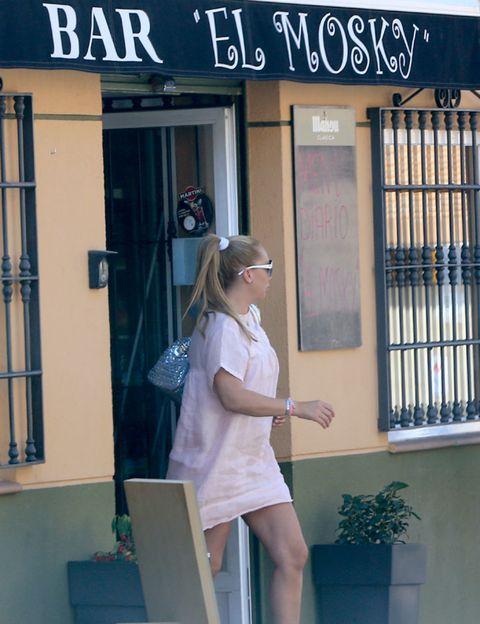 Human body, Door, Street fashion, Sunglasses, Waist, Flowerpot, Lectern, Home door,