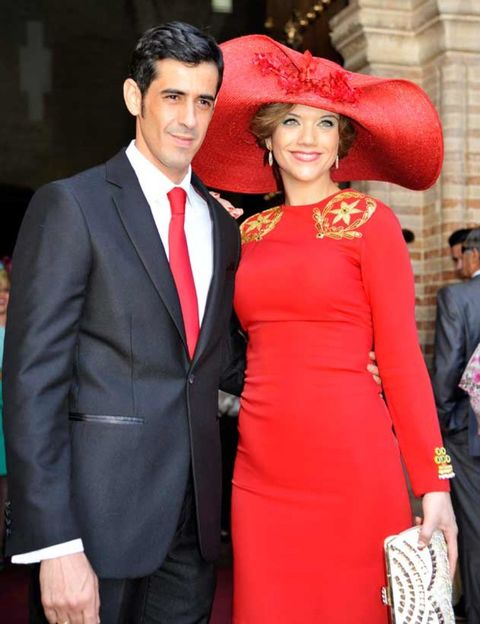 Clothing, Smile, Coat, Trousers, Dress, Dress shirt, Red, Shirt, Hat, Outerwear,