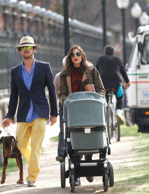 Tire, Wheel, Human, Product, Baby carriage, Hat, Baby Products, Carnivore, Street fashion, Dog,