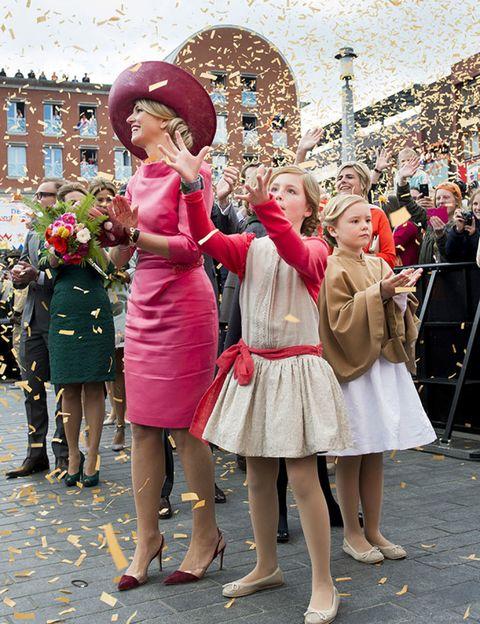 Dress, Pink, Hat, One-piece garment, Crowd, Fashion, Costume accessory, Magenta, Day dress, Street fashion,
