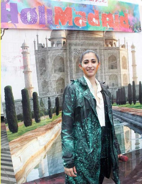 Street fashion, Jacket, Temple, Travel, Paint, Visual arts, Historic site, History, Painting, Column,