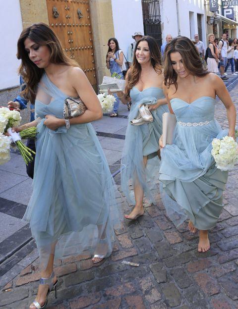 Clothing, Blue, Trousers, Shoulder, Dress, Textile, Strapless dress, Bouquet, Photograph, Joint,