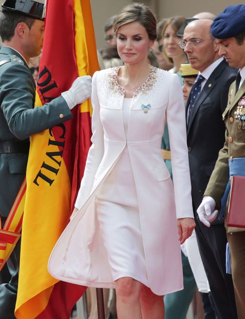 Outerwear, Coat, Dress, Formal wear, Suit, Flag, Fashion accessory, Fashion, One-piece garment, Necklace,