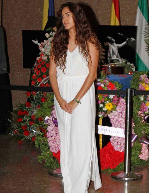 Flag, Dress, Formal wear, Petal, Floristry, Flower Arranging, Bouquet, Gown, Floral design, Wedding dress,