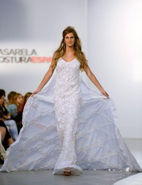 Clothing, Fashion show, Shoulder, Textile, Runway, Fashion model, Formal wear, Gown, Style, Dress,