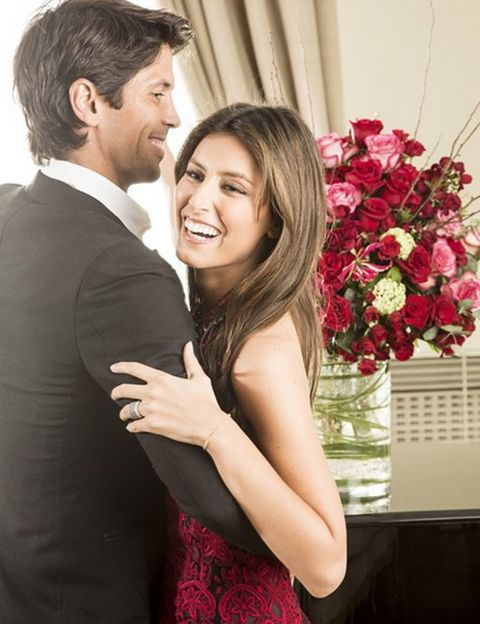 Smile, Eye, Bouquet, Petal, Coat, Dress, Red, Happy, Formal wear, Facial expression,
