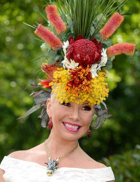 Mouth, Flower, Fashion accessory, Headgear, Beauty, Hair accessory, Tradition, Costume accessory, Headpiece, Lipstick,