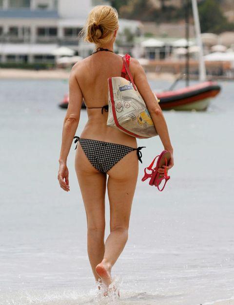 Human leg, Waist, Summer, Brassiere, Swimsuit bottom, Undergarment, Watercraft, Thigh, Back, Bikini,