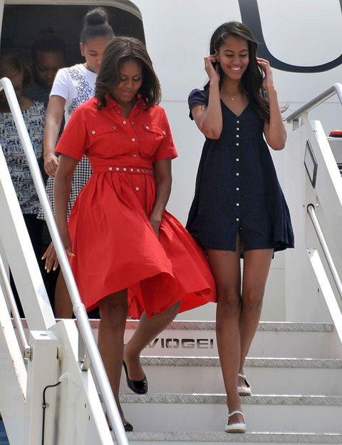 Leg, Sleeve, Dress, Shoulder, Human leg, Shoe, Standing, White, Red, One-piece garment,