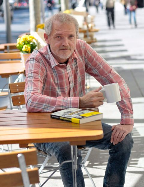 Sitting, Table, Furniture, Denim, Outdoor furniture, Outdoor table, Reading, Plaid, Wrinkle, Publication,