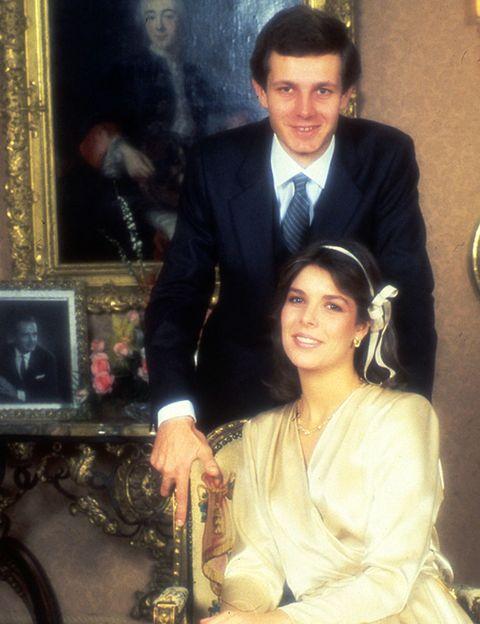 Human, Outerwear, Formal wear, Coat, Suit, Blazer, Bridal clothing, Picture frame, Tie, Bride,
