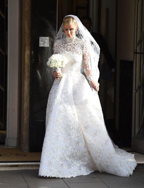Clothing, Dress, Bridal clothing, Sleeve, Shoulder, Textile, Bridal veil, Wedding dress, Photograph, Veil,