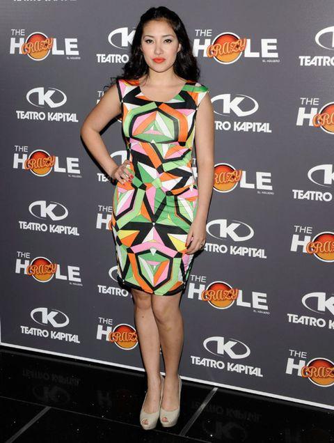 Human, Dress, Shoulder, Joint, Style, One-piece garment, Orange, Fashion model, Eyelash, Cocktail dress,