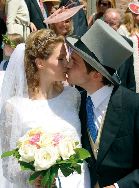 Clothing, Hat, Event, Petal, Bouquet, Coat, Photograph, Outerwear, Happy, Formal wear,