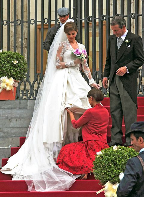 Trousers, Event, Coat, Dress, Outerwear, Bridal veil, Bridal clothing, Suit, Formal wear, Veil,