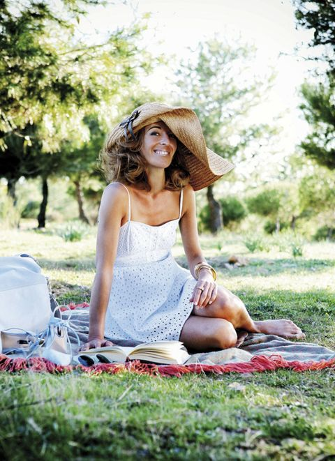 Dress, People in nature, Sitting, Hat, Summer, Headgear, Helmet, Bag, Sun hat, Street fashion,