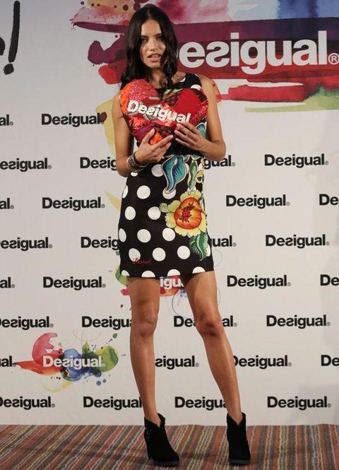 Shoe, Dress, Style, Fashion, Thigh, Day dress, One-piece garment, Knee, Fashion model, High heels,