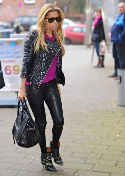 Clothing, Eyewear, Human body, Textile, Bag, Photograph, Outerwear, Sunglasses, Pink, Fashion accessory,