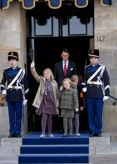 Stairs, Standing, Uniform, Hat, Coat, Jacket, Costume accessory, Official, Suit trousers, Costume hat,