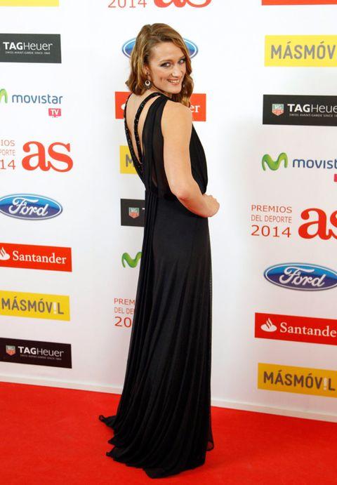 Dress, Flooring, Shoulder, Premiere, Style, Formal wear, Carpet, Logo, Eyelash, Public event,