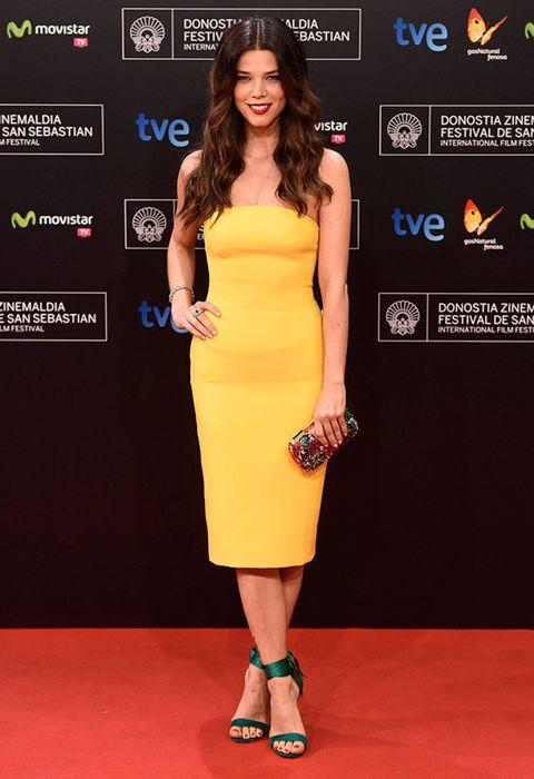 Clothing, Human, Yellow, Dress, Shoulder, Flooring, Human leg, Joint, Red, One-piece garment,