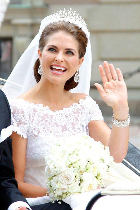 Clothing, Bridal clothing, Eye, Bouquet, Dress, Eyebrow, Petal, Photograph, White, Wedding dress,