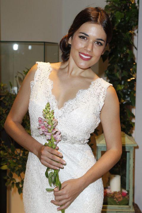 Clothing, Dress, Shoulder, Textile, Joint, Bridal clothing, Wedding dress, Waist, Gown, Bouquet,