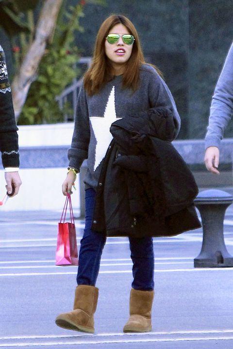 Eyewear, Sleeve, Human leg, Textile, Outerwear, Sunglasses, Boot, Winter, Style, Bag,
