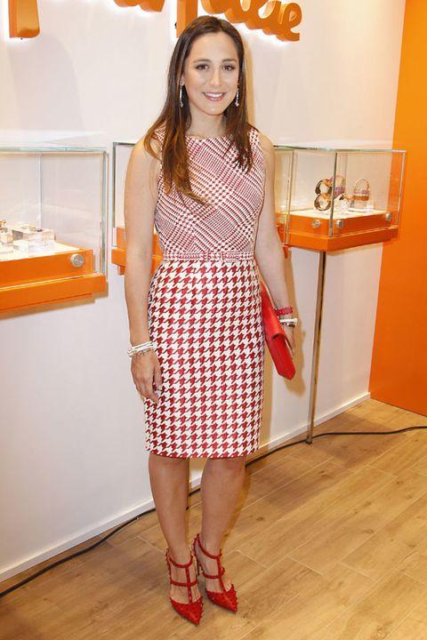 Clothing, Floor, Dress, Flooring, Shoulder, Orange, Human leg, Red, Style, One-piece garment,