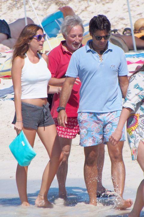 Clothing, Eyewear, Leg, Vision care, Glasses, Human body, Summer, Shorts, People on beach, T-shirt,