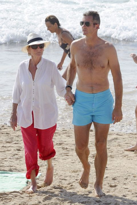 Eyewear, Vision care, Glasses, Fun, Goggles, People on beach, Human body, Sunglasses, Shirt, Beach,