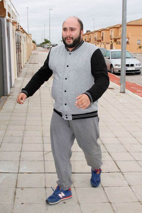 Sleeve, Shoe, Outerwear, Standing, Beard, Street fashion, Sneakers, Grey, Athletic shoe, Composite material,