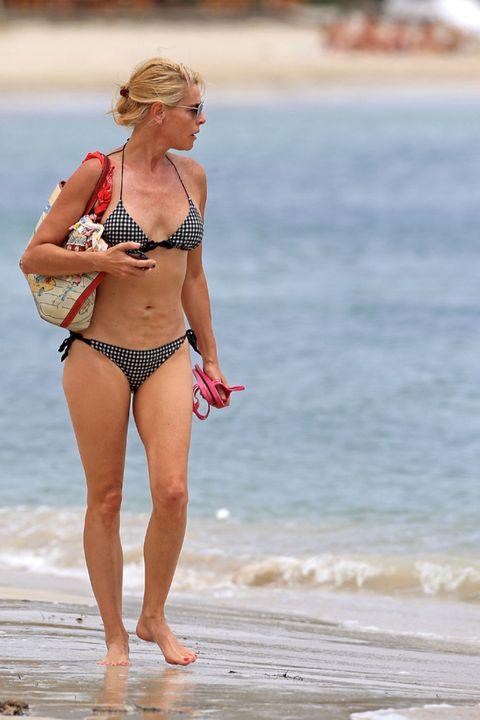 Clothing, Brassiere, Human leg, Summer, Coastal and oceanic landforms, Swimwear, Beach, Swimsuit top, People on beach, Undergarment,