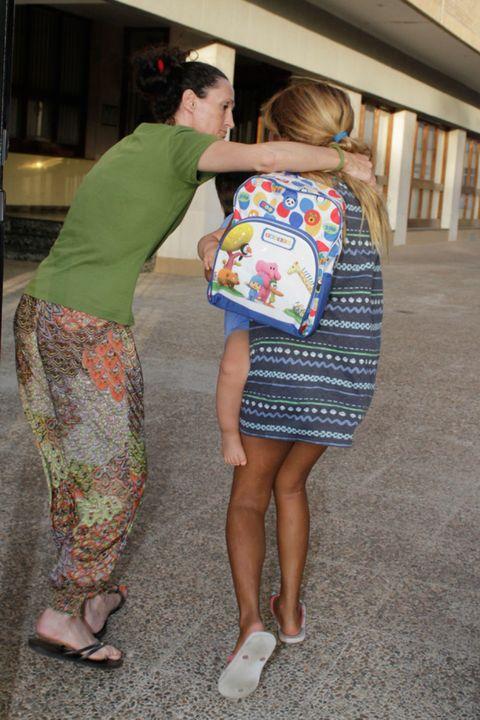 Leg, Human leg, Shoulder, Joint, Standing, Interaction, Bag, Dress, One-piece garment, Foot,