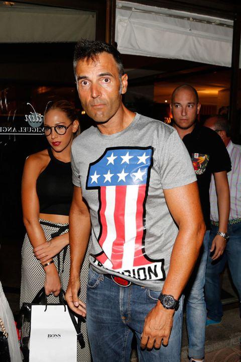 Face, Trousers, Denim, Jeans, Shirt, T-shirt, Logo, Fashion accessory, Bag, Belt,