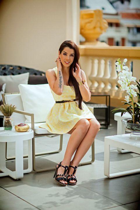 Dress, Human leg, Style, Fashion accessory, Sitting, Youth, One-piece garment, Thigh, Day dress, Cocktail dress,