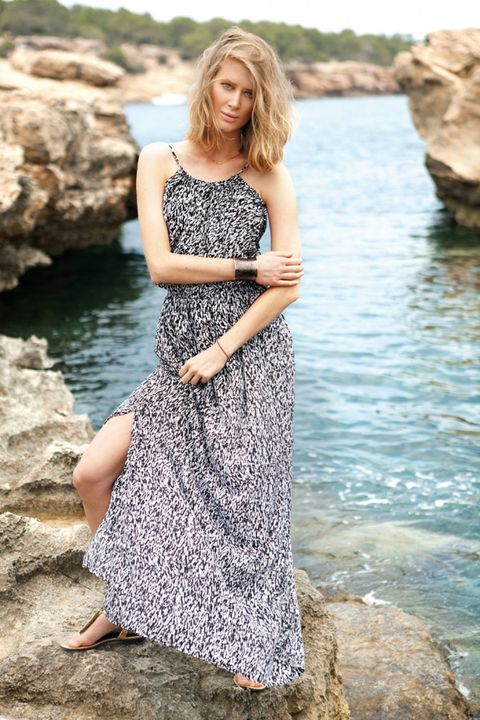 Clothing, Dress, Shoulder, Photograph, Rock, Summer, One-piece garment, People in nature, Bank, Beauty,